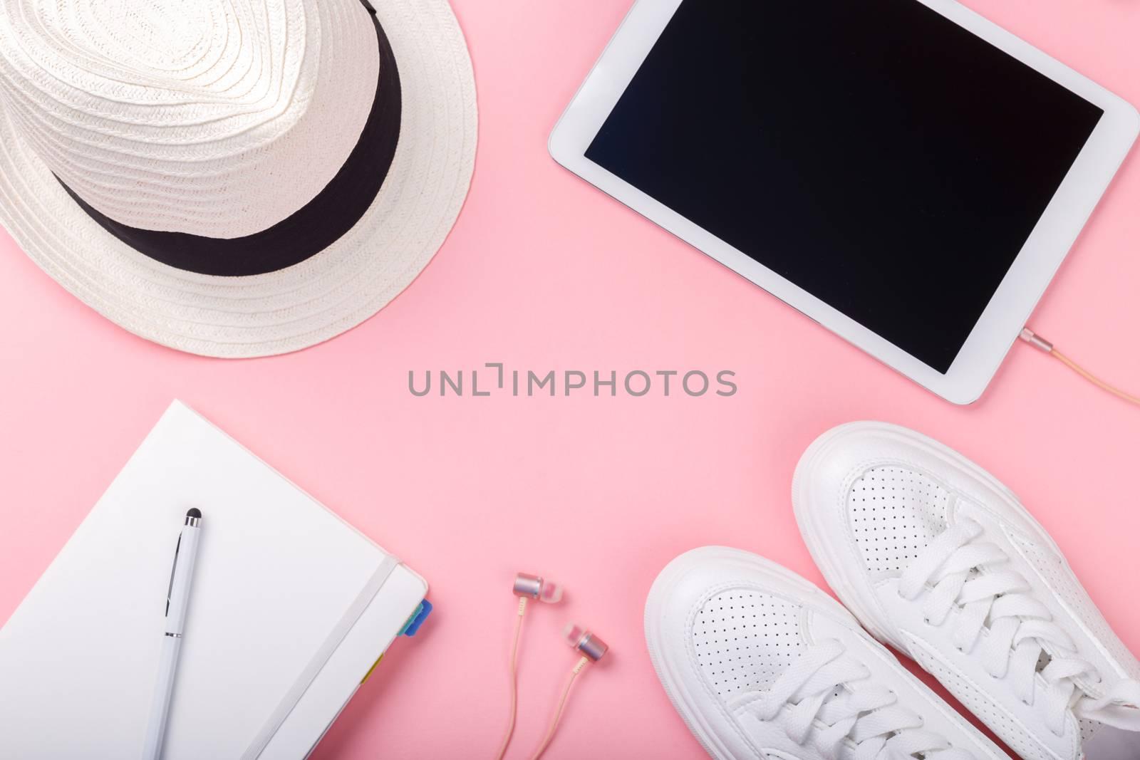 Fashion blogger traveler concept minimal set of feminine accessories on pink trendy background