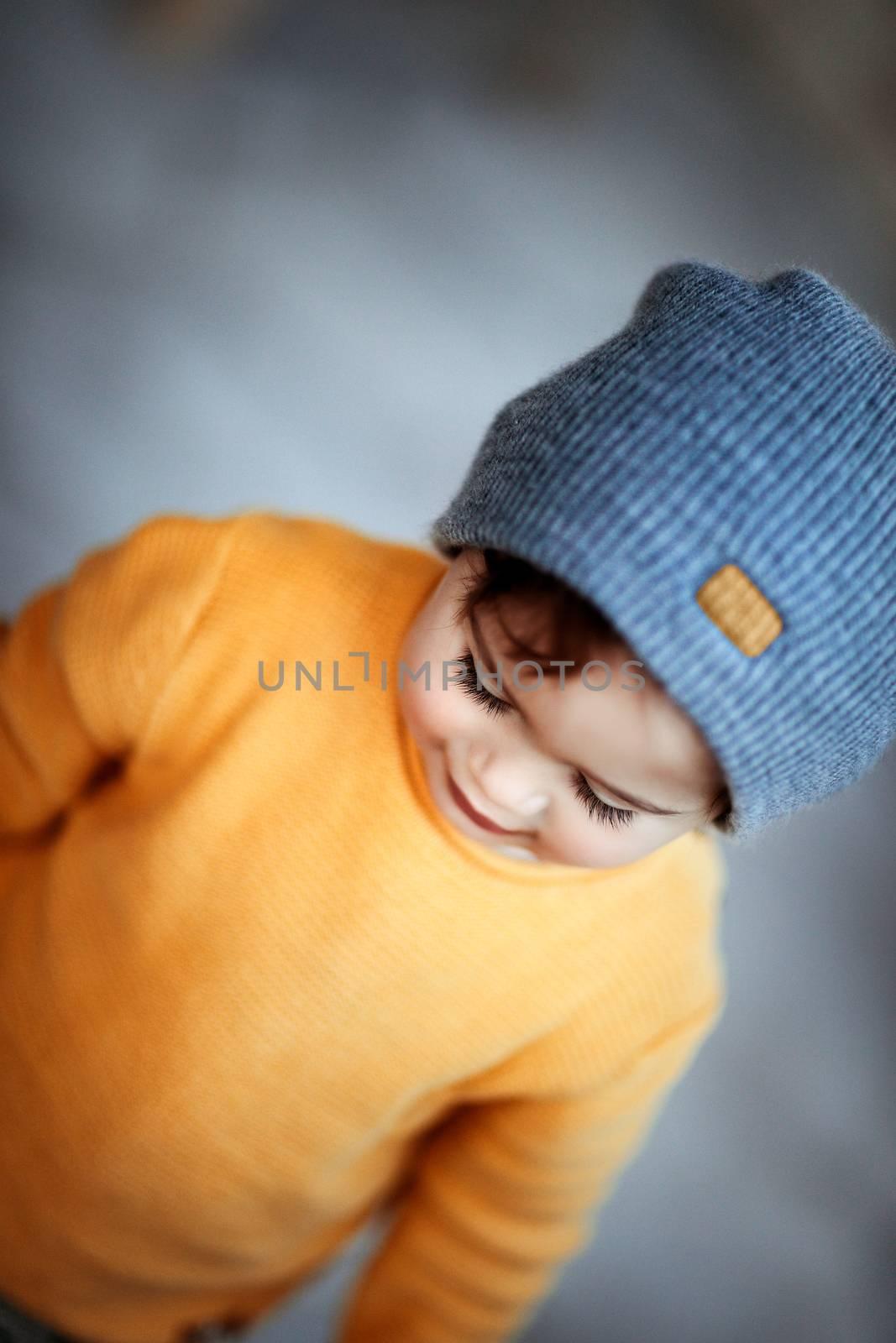 Cute baby boy wearing stylish warm clothes, kids fashion, autumn season, cute trendy little child
