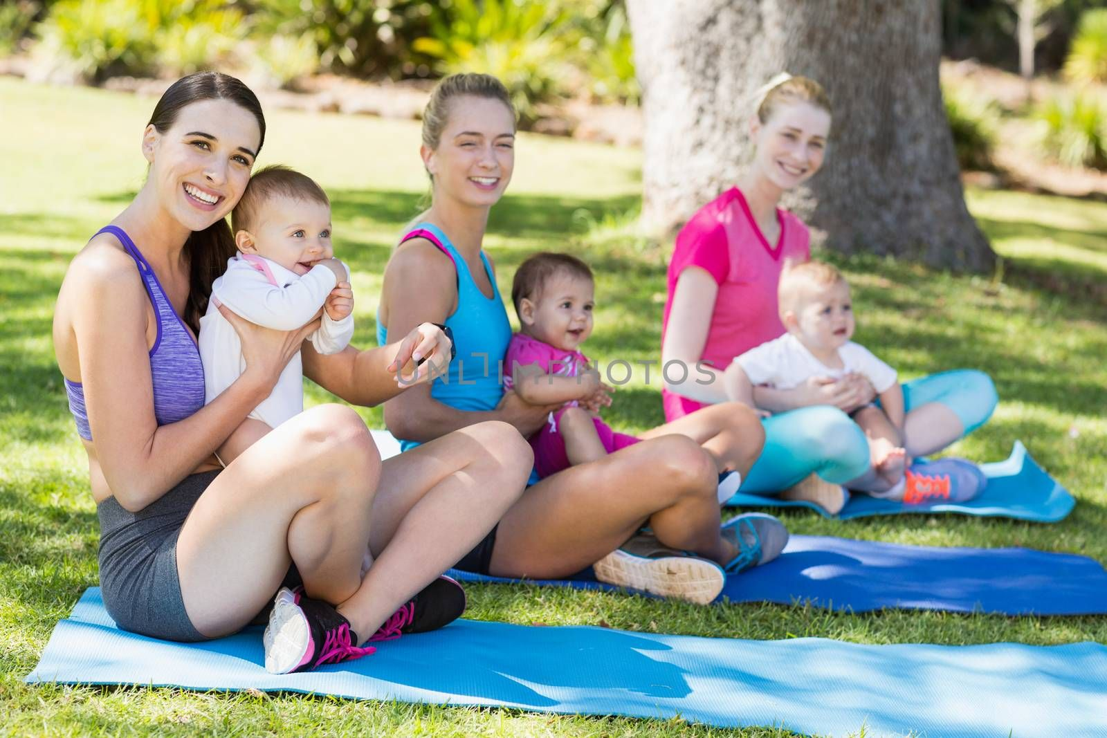 Women sitting with their babies in park