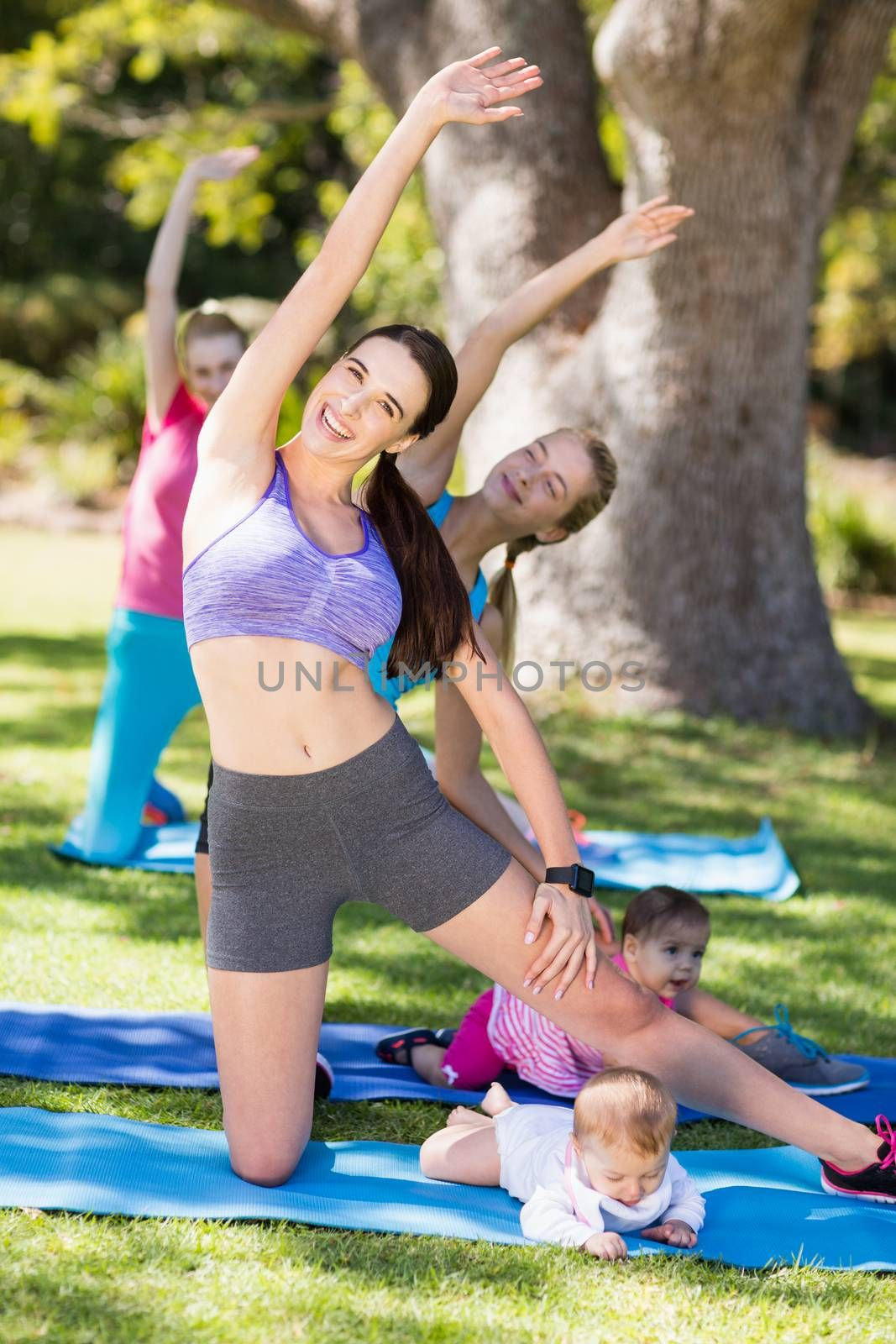 Women exercising with their babies in park