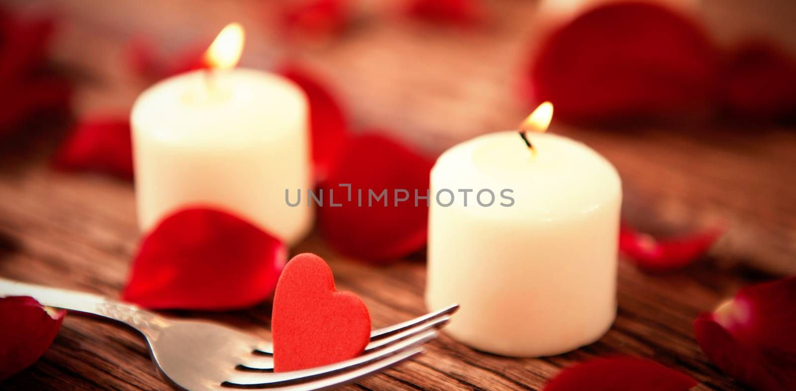 romantic candles with heart decoration