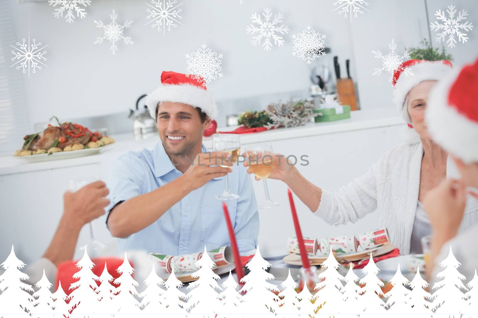 Happy family clinking their glasses of white wine against fir tree forest and snowflakes