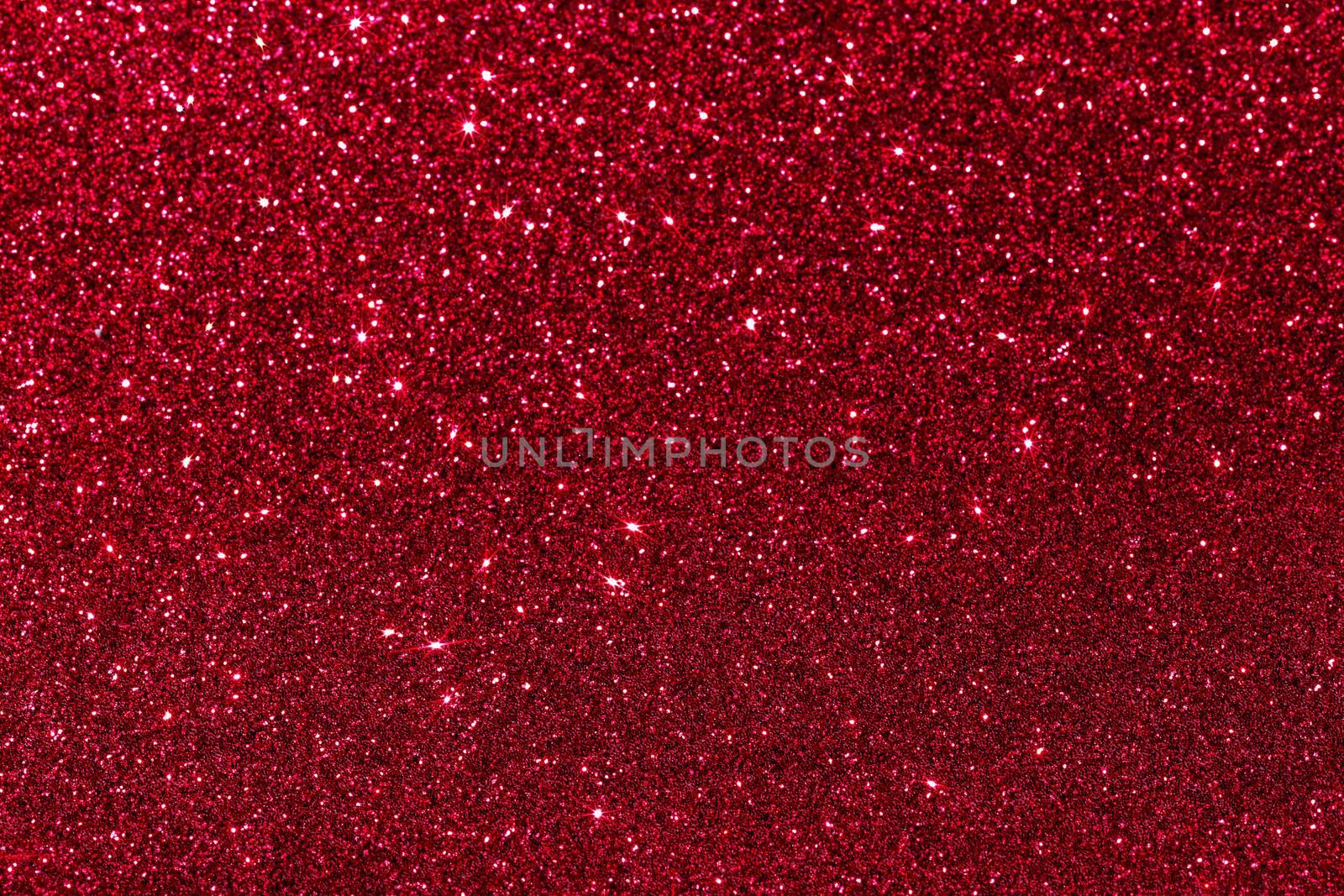 Red glitter texture holidays background. Macro shot