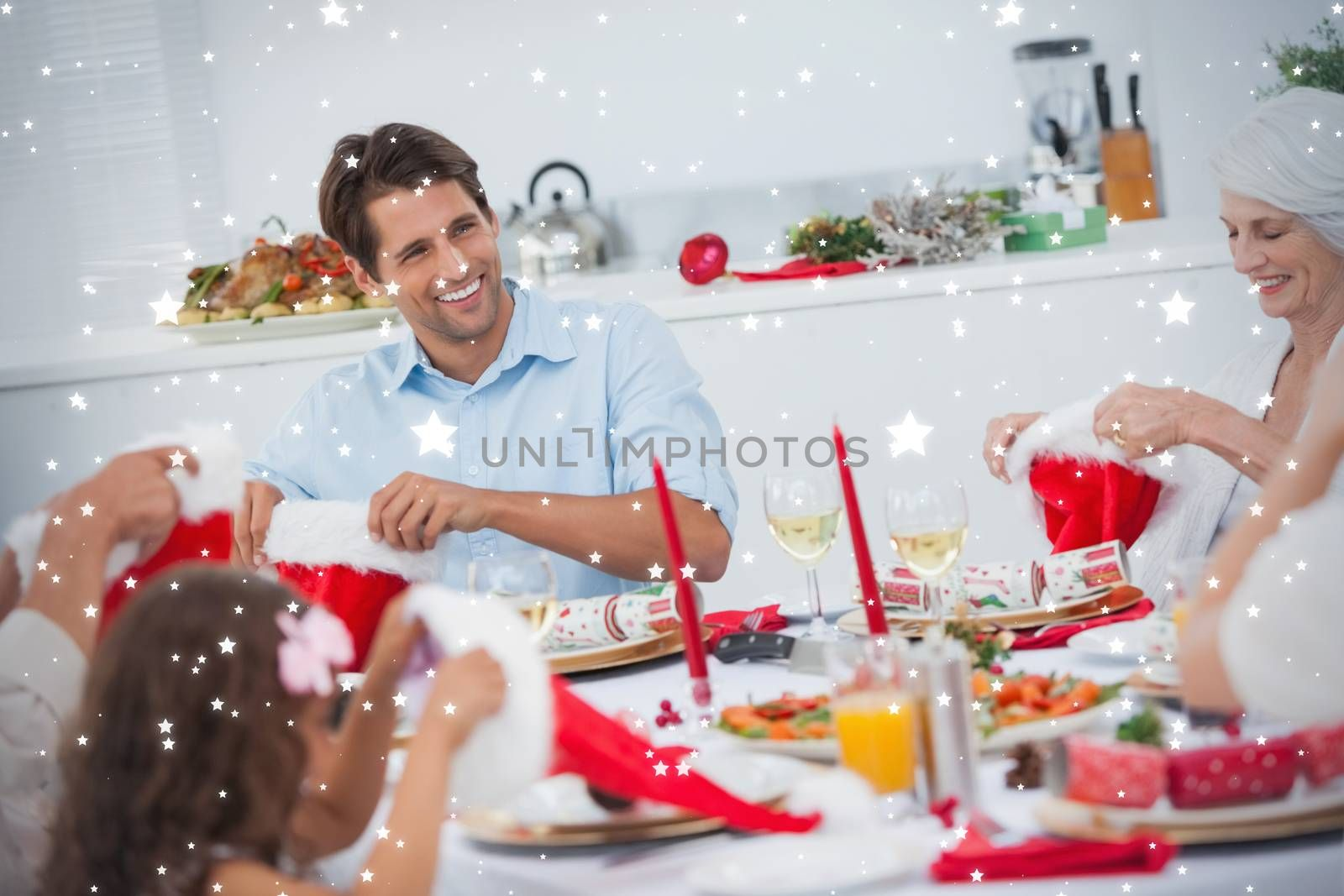 Composite image of Cheerful family dining together against snow