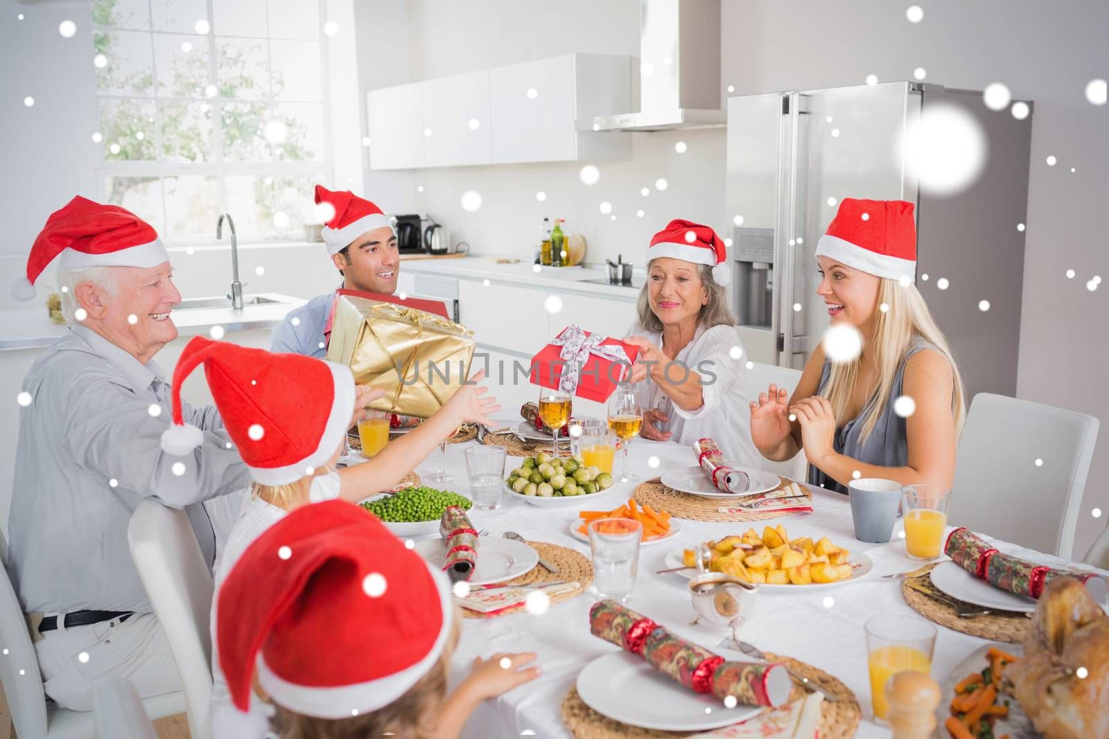 Composite image of Family swapping christmas presents against snow