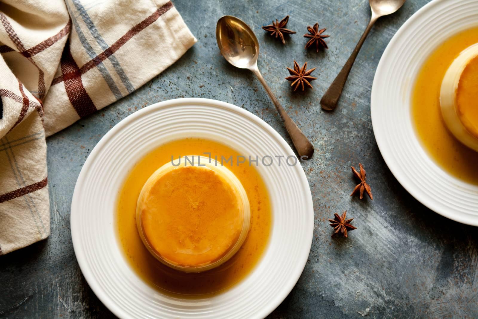 Small homemade sweet caramel pudding close up