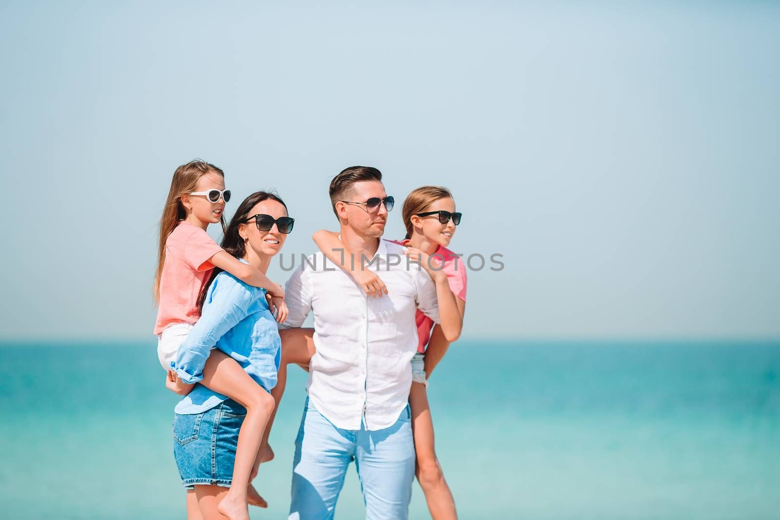 Family beach vacation. Portrait of family with kids