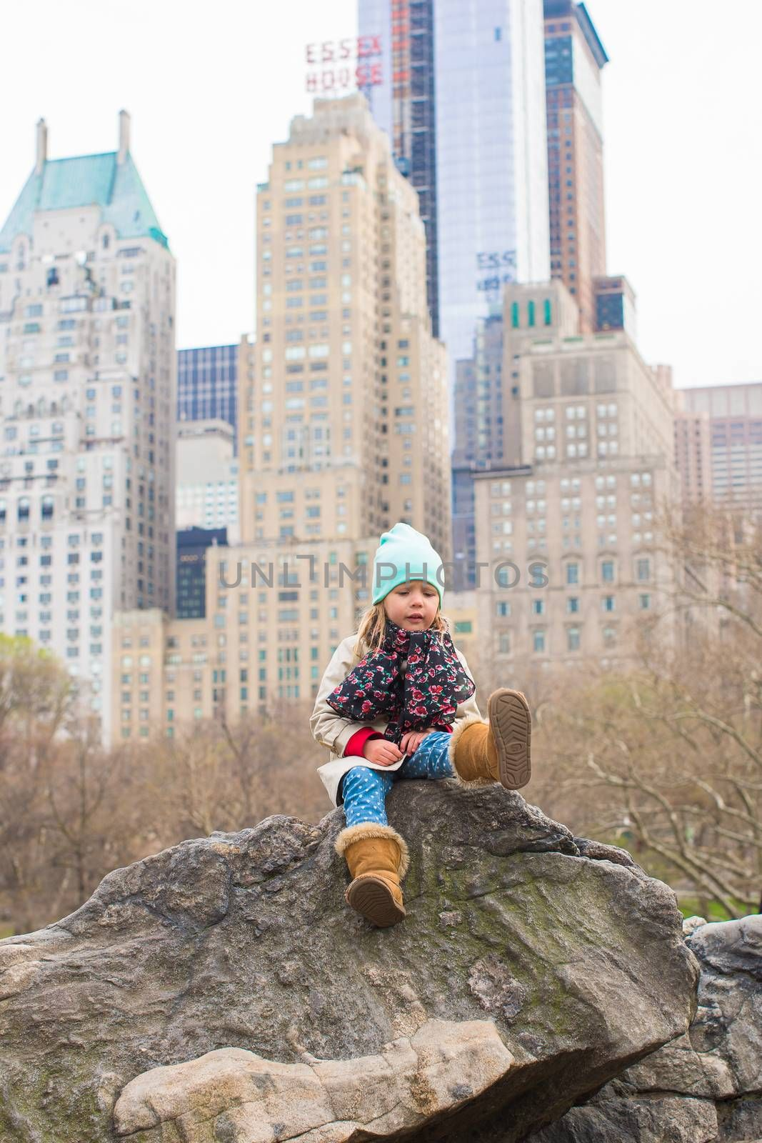 Pretty little girl relax at beauty city landscape