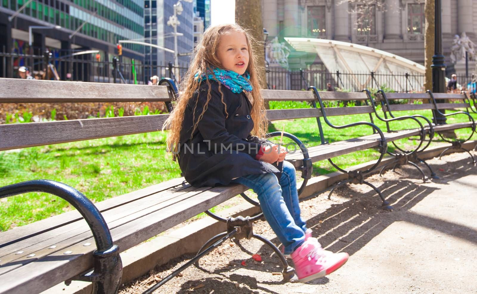 Pretty little girl relax at beauty autumn landscape background