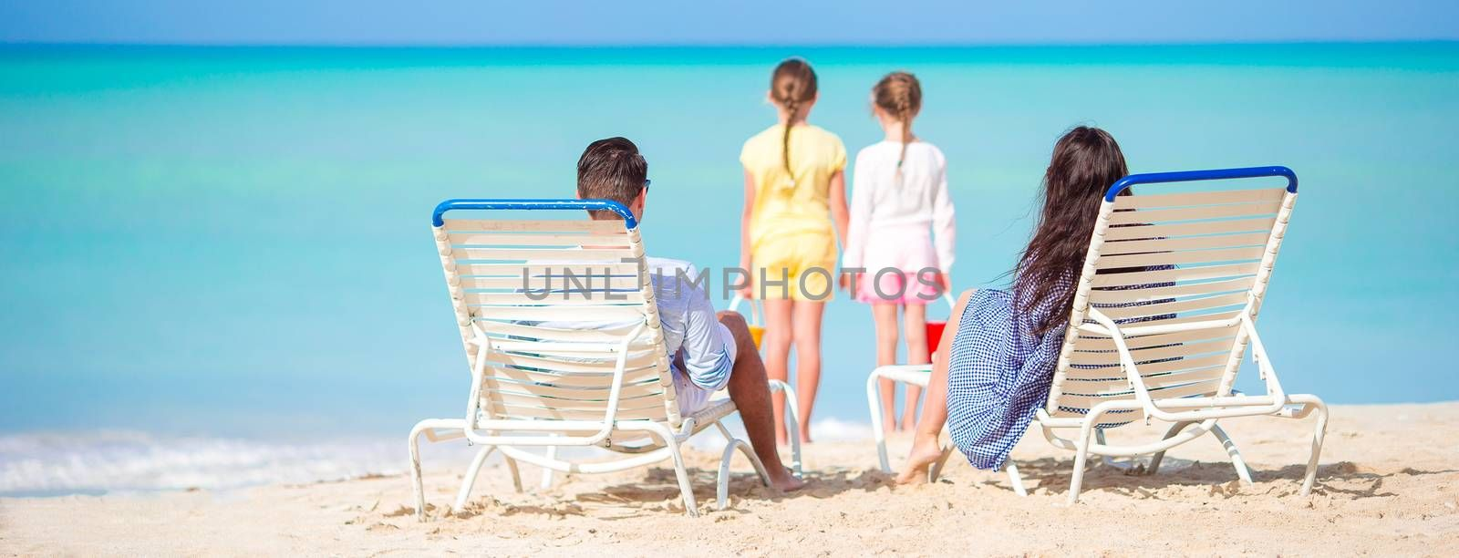 Panorama of happy family on the beach during summer vacation