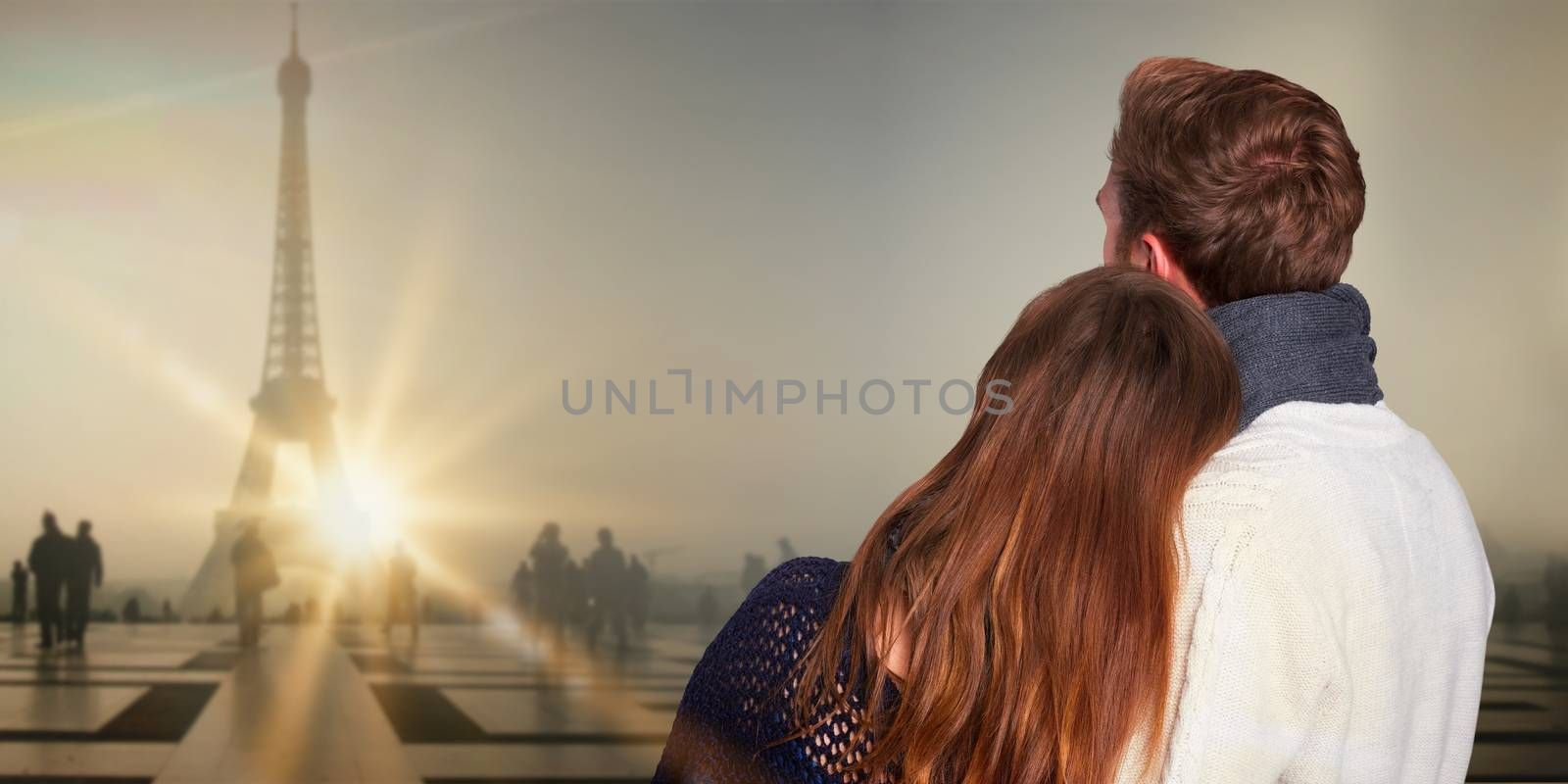 Close up rear view of romantic couple against eiffel tower