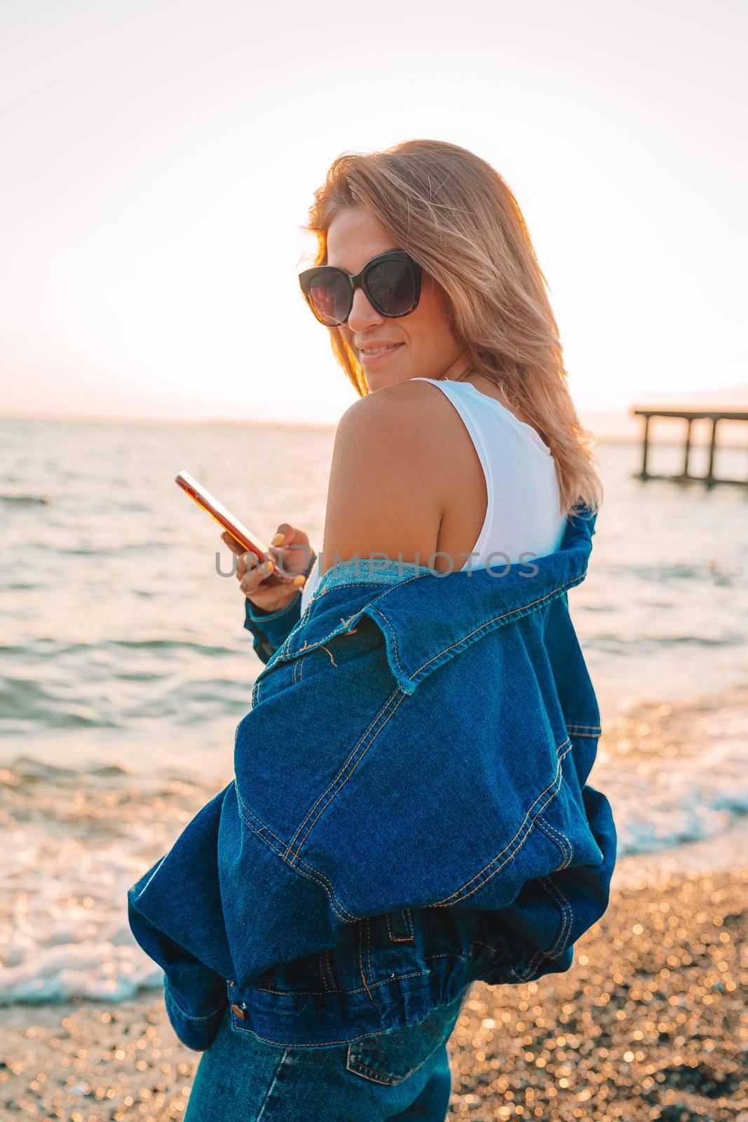 Fashion portrait of stylish girl on the beach.