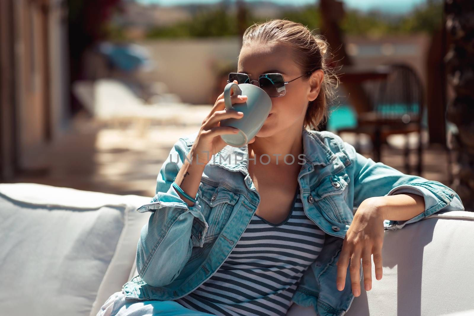 Portrait Of a Pretty Woman Sitting with Cup of Coffee in Outdoors Cafe. Enjoying Tasty Beverage. Spending Summer Weekend Spending Summer Weekend in the City. Coffee Break
