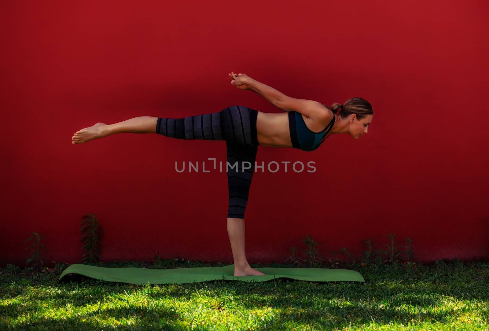 Beautiful Young Woman Doing Yoga Outdoors. Virabhadrasana. Warrior 3. One-Legged Pose. Enjoying Healthy Life and Sport.