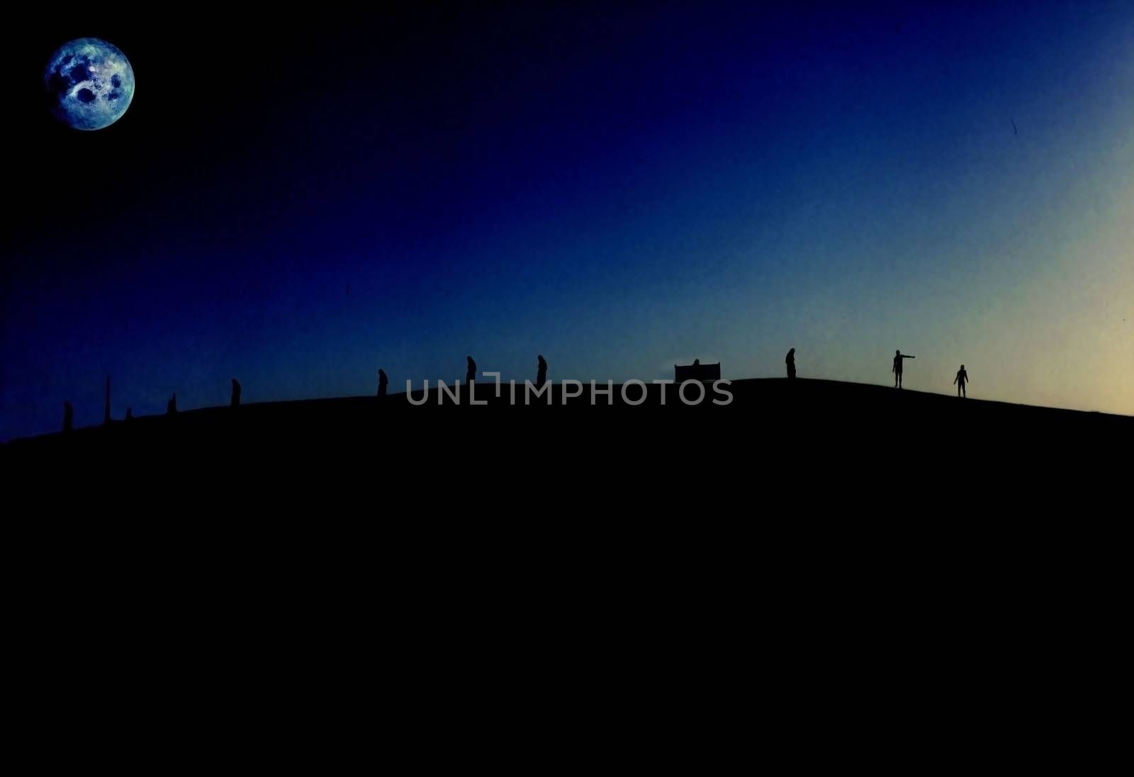 Evening silhouettes of people on mountain. Full moon in night sky
