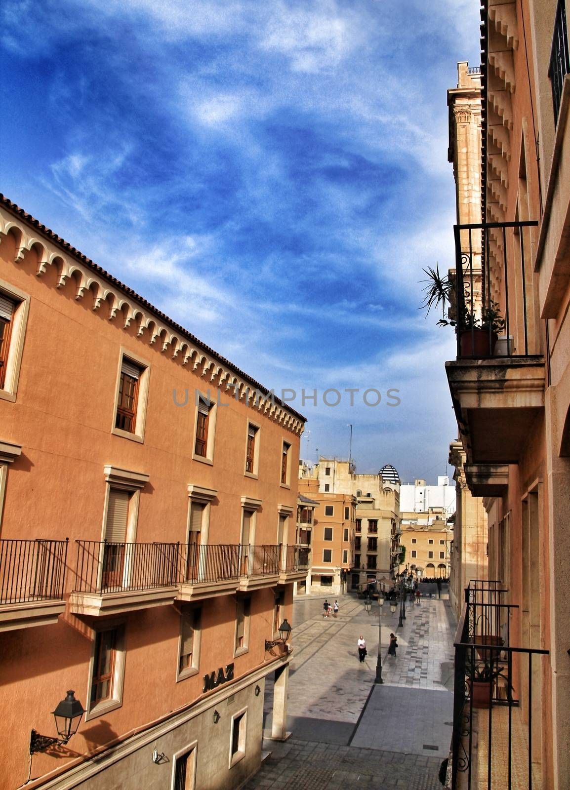Elche, Alicante, Spain- September 12, 2018: People walking through Eucharistic Convent Square in Elche, Alicante in a sunny day of summer