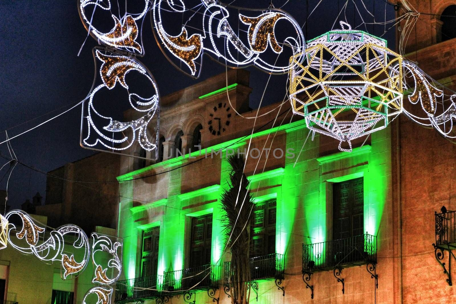 Elche, Spain- August 13, 2018: Elche town hall square decorated with colorful bulbs and garlands for the festivities