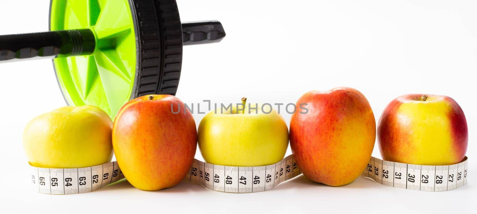 Healthy lifestyle, fitness, fruits, sport, athlete's equipment on white background. Copy space.