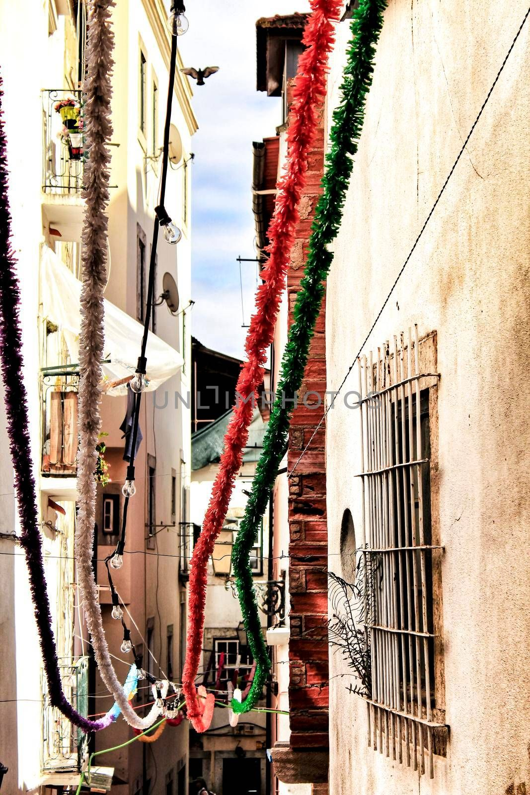 Streets adorned with garlands for the festivities of Saint Anthony in the Alfama neighborhood in Lisbon