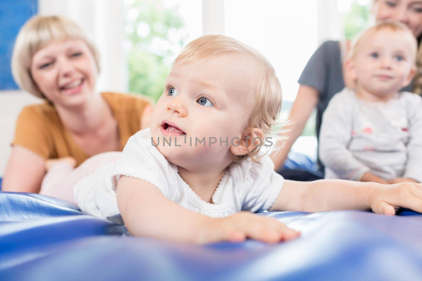 Babies and moms in postnatal mother and child course