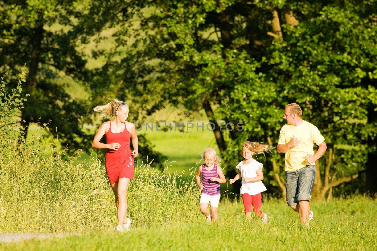 Family  jogging with two little daughters