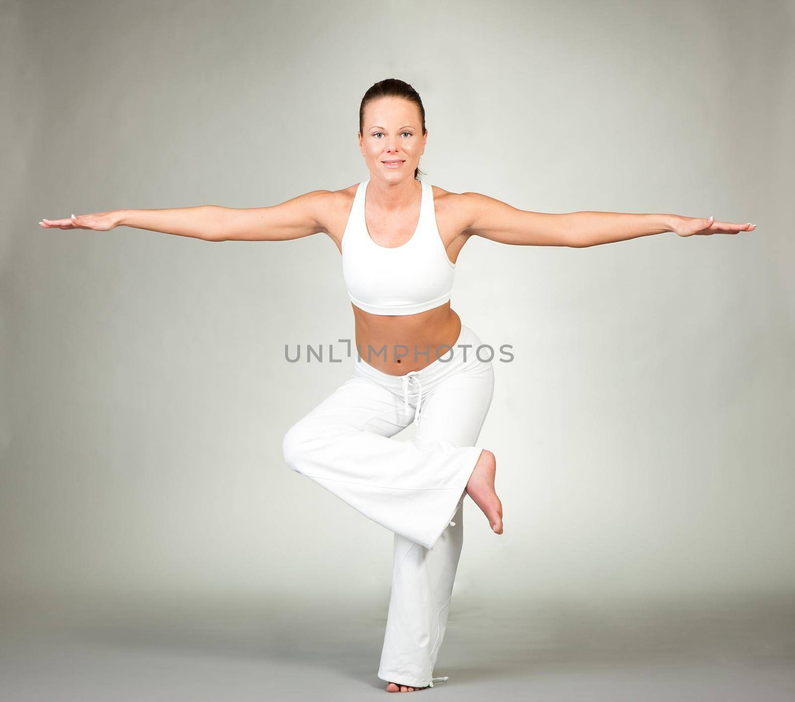 Young woman in a yoga position