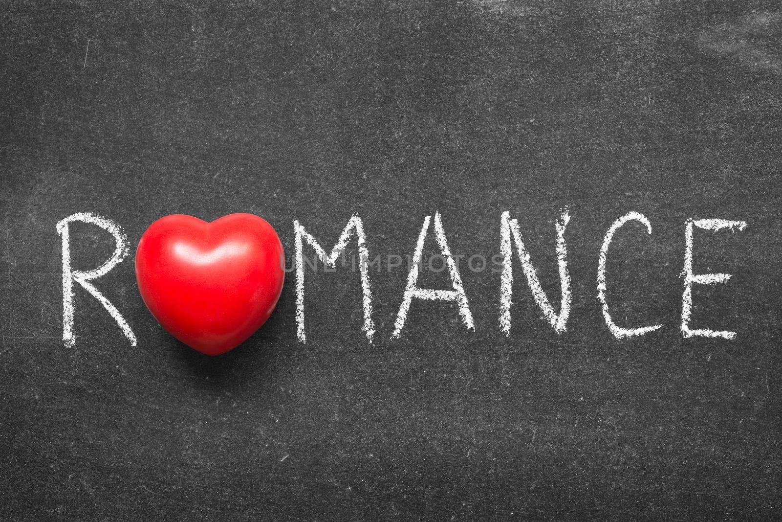 romance word handwritten on chalkboard with heart symbol instead of O