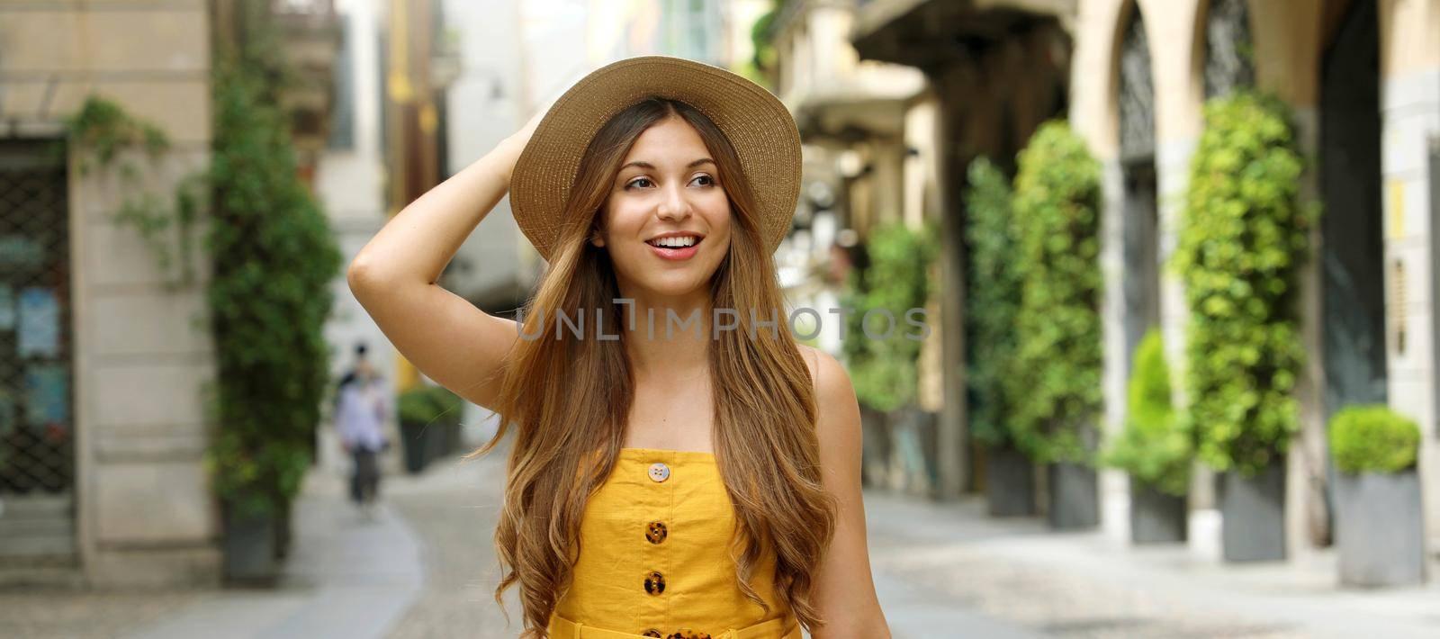 Portrait of fashion woman walking in Brera neighborhood in Milan, Italy. Banner view.
