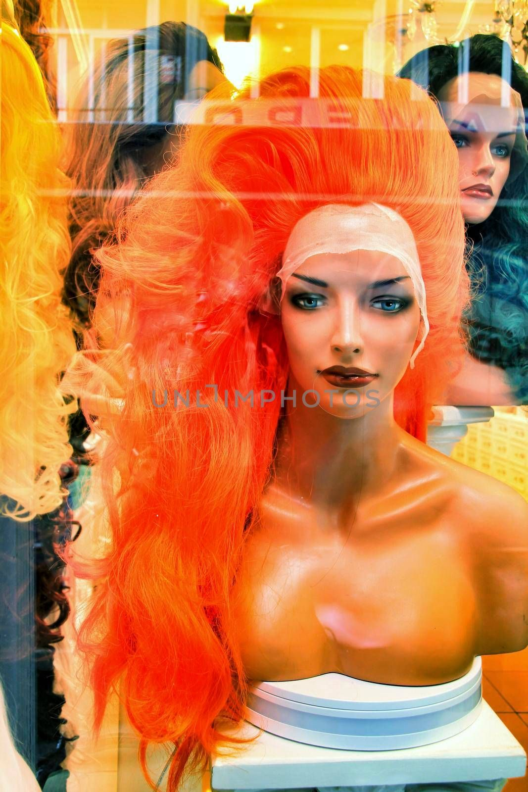 Showcase in store with colorful wigs for drag queens