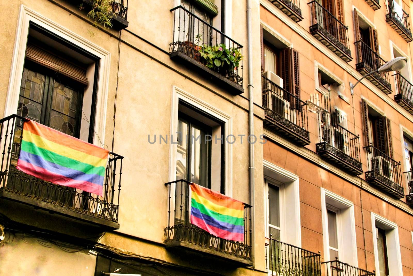 Facade with gay pride flag on its balconies in Chueca, Madrid