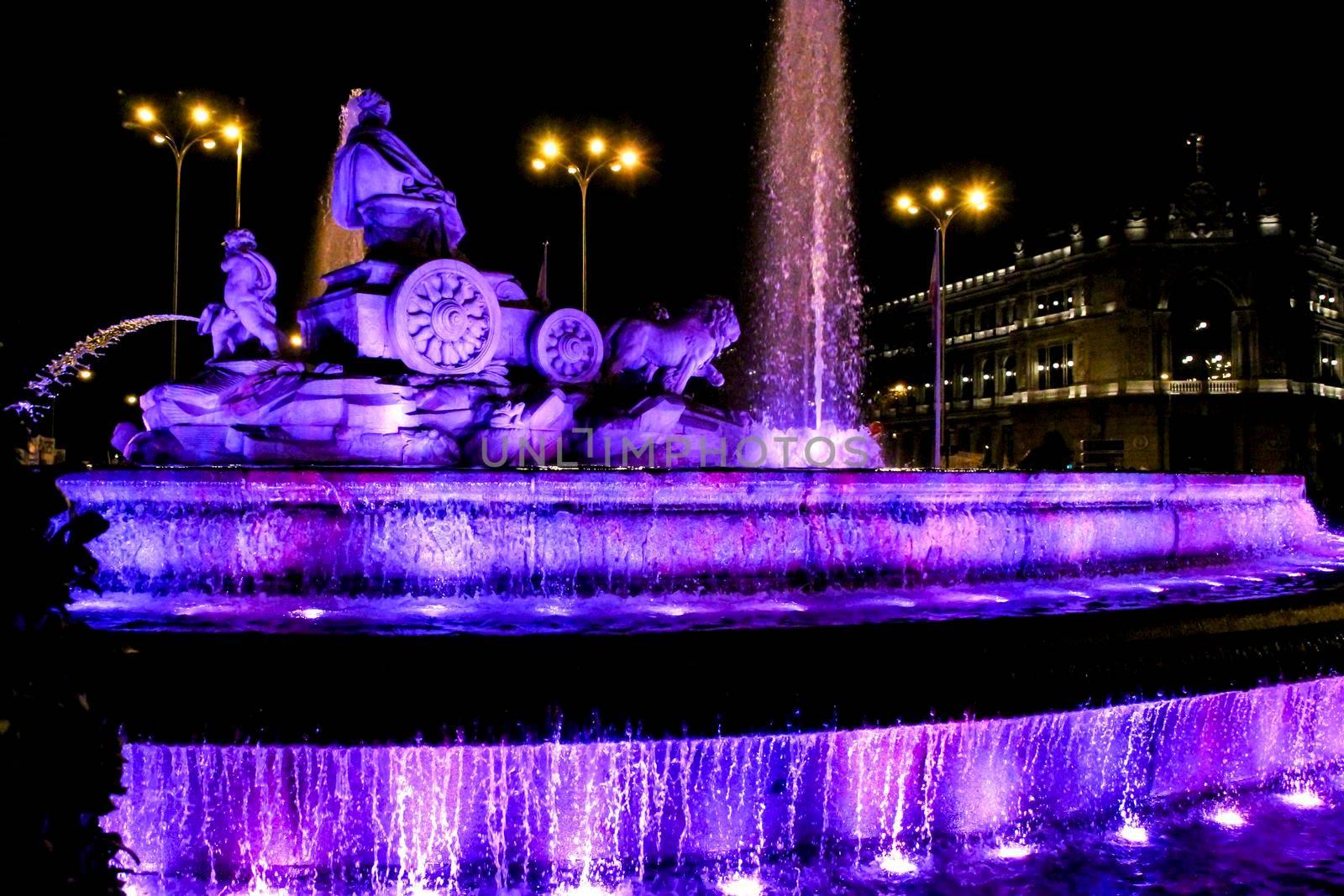 Beautiful Cibeles fountain illuminated in purple in the International Women's Day