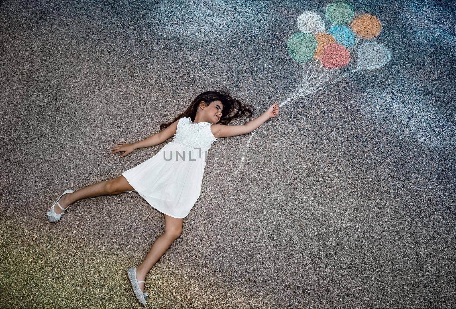 Conceptual Image of Freedom Joy and Happiness. Little Girl Flying Away on Colorful Balloons. Enjoying Life. Dreamy Childhood. Creative Imagination.