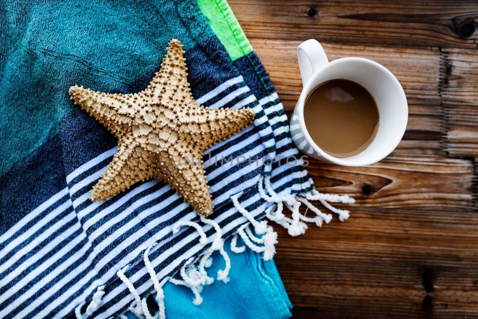 Closeup Photo of a Beautiful Still Life in Beach House. Morning Coffee and Starfish. Relaxing Summer Vacation Concept.