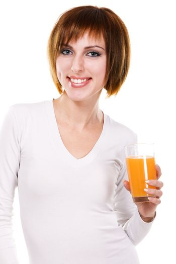 Lovely young woman with a glass of fresh juice against white background
