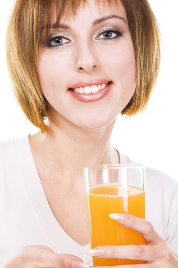 Lovely young woman with a glass of fresh orange juice