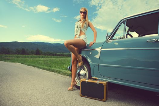 Fashion model with vintage cars, summer travel