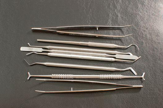 Set of metal medical equipment tools for teeth dental care .