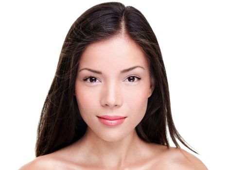 Beautiful ethnic woman. Beauty portrait of mixed race Asian Caucasian female beauty model isolated on white background. Closeup of woman with long dark hair.