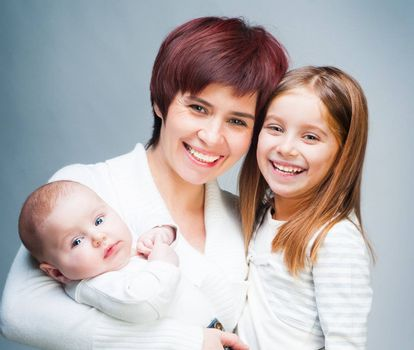 Smiling mother with her cute kids