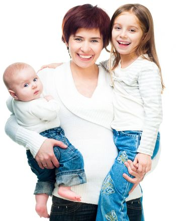 Smiling mother with daughters isolated on a white background