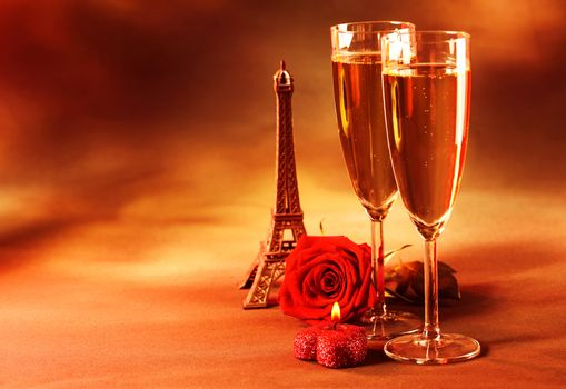 Picture of two glass of champagne on the table in restaurant, party dinner, wedding day, festive drink for Valentine day holiday, grunge background, fresh rose, Eiffel tower, love and romance concept