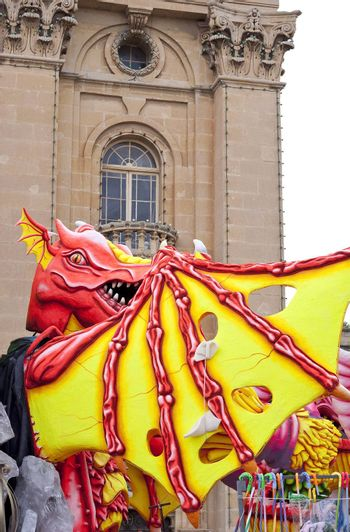 A colorful dragon made out of papier mache used during carnival festivities in Malta