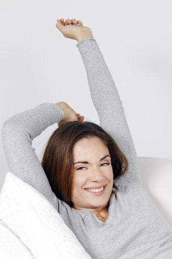Beauty woman relaxing on sofa at home
