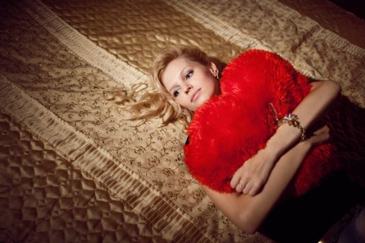 beauty with a red pillow