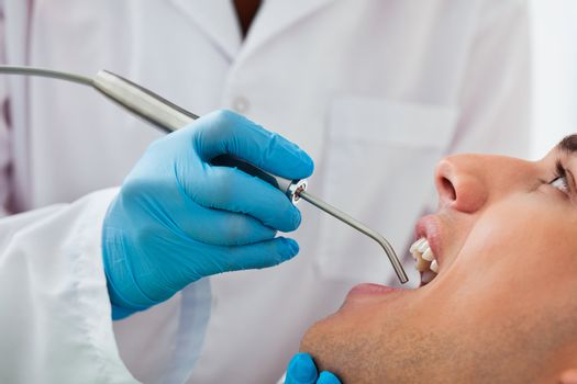 Dentist working on patient at clinic