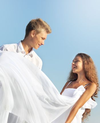 Romantic couple outdoors at sunny summer day