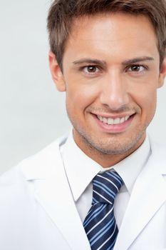 Closeup portrait of male dentist smiling