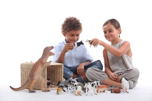 Child playing with toy animals