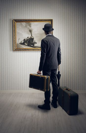 Man with suitcases waiting for the train, conceptual photo