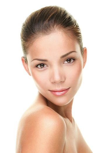 Beauty skin care face portrait of asian young woman looking at camera isolated on bright white background. Perfect skin complexion of multicultural mixed race Asian Caucasiaon beautiful gorgeous girl.